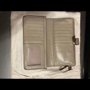 Coach wallet taupe with multiple storage areas
